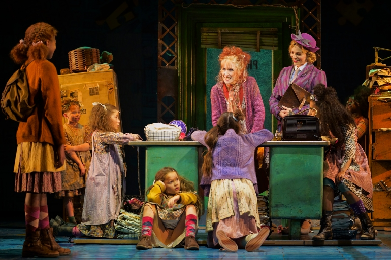 3. ANNIE. Anita Dobson 'Miss Hannigan', Carolyn Maitland 'Grace Farrell' and company. Photo Paul Coltas